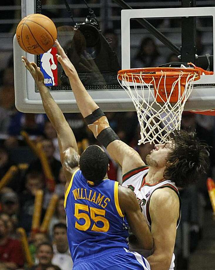 Milwaukee Bucks' Andrew Bogut, right, blocks the shot by Golden State Warriors' Reggie Williams(55) in the second half of an NBA basketball game Saturday, Nov, 30, 2010, in Milwaukee. Photo: Jeffrey Phelps, AP