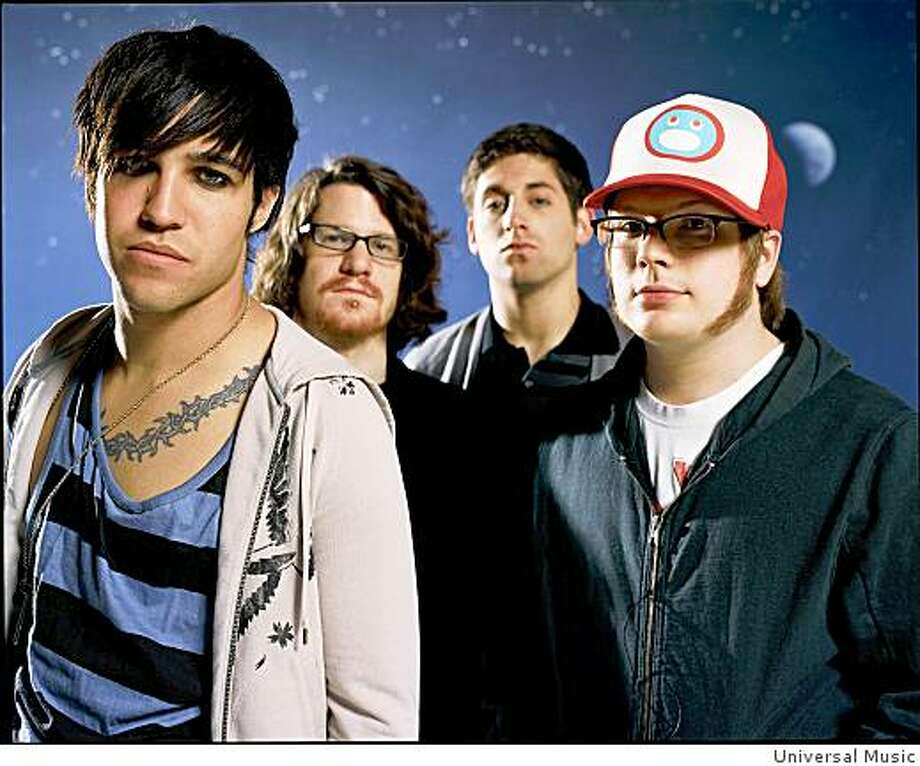 Fall Out Boy singer Patrick Stump, far right, doesn't mind sharing the spotlight with the group's bass player Pete Wentz, far left. Photo: Universal Music
