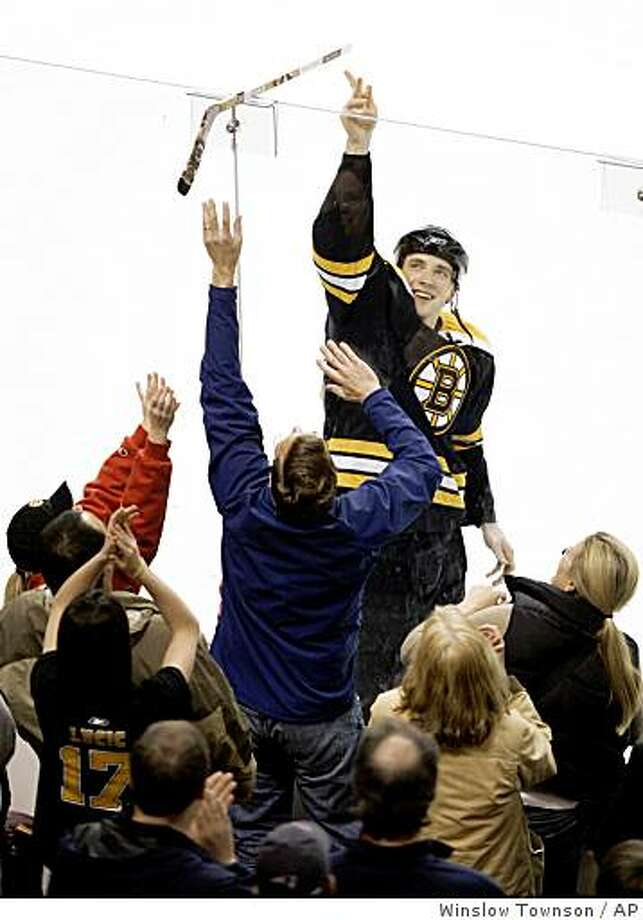 Boston Bruins' Blake Wheeler tosses an autographed stick to the fans after their 1-0 win over the New York Rangers in which he scored the game's only goal during an NHL hockey game in Boston Saturday, April 4, 2009. (AP Photo/Winslow Townson) Photo: Winslow Townson, AP