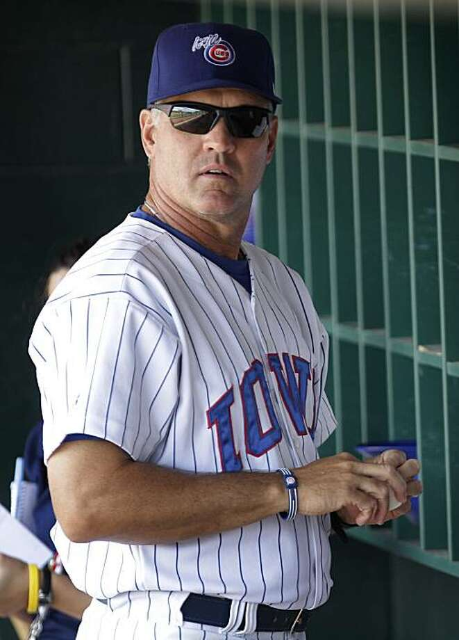 FILE - In this July 20, 2010, file photo, Iowa Cubs manager Ryne Sandberg stands in the dugout before his baseball team's game against the Oklahoma City Redhawks in Des Moines, Iowa. The Philadelphia Phillies have hired Sandberg to manager their Triple-Aaffiliate, the Lehigh Valley IronPigs. Photo: Charlie Neibergall, AP