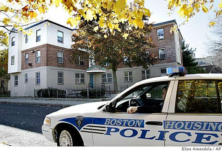 A police officer sits in his cruiser Thursday, Oct. 30, 2008 outside the public housing complex in South Boston where Democratic presidential candidate Sen. Barack Obama's aunt Zeituni Onyango reportedly lives. The Kenyan woman who has been quietly living in public housing in Boston, is in the United States illegally after an immigration judge rejected her request for asylum four years ago, The Associated Press has learned. (AP Photo/Elise Amendola) Photo: Elise Amendola, AP