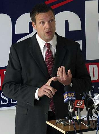 In this photo from Thursday, Oct. 28, 2010, Kris Kobach, the Republican candidate for Kansas secretary of state, discusses election fraud issues during a news conference in Topeka, Kan. Photo: John Hanna, AP