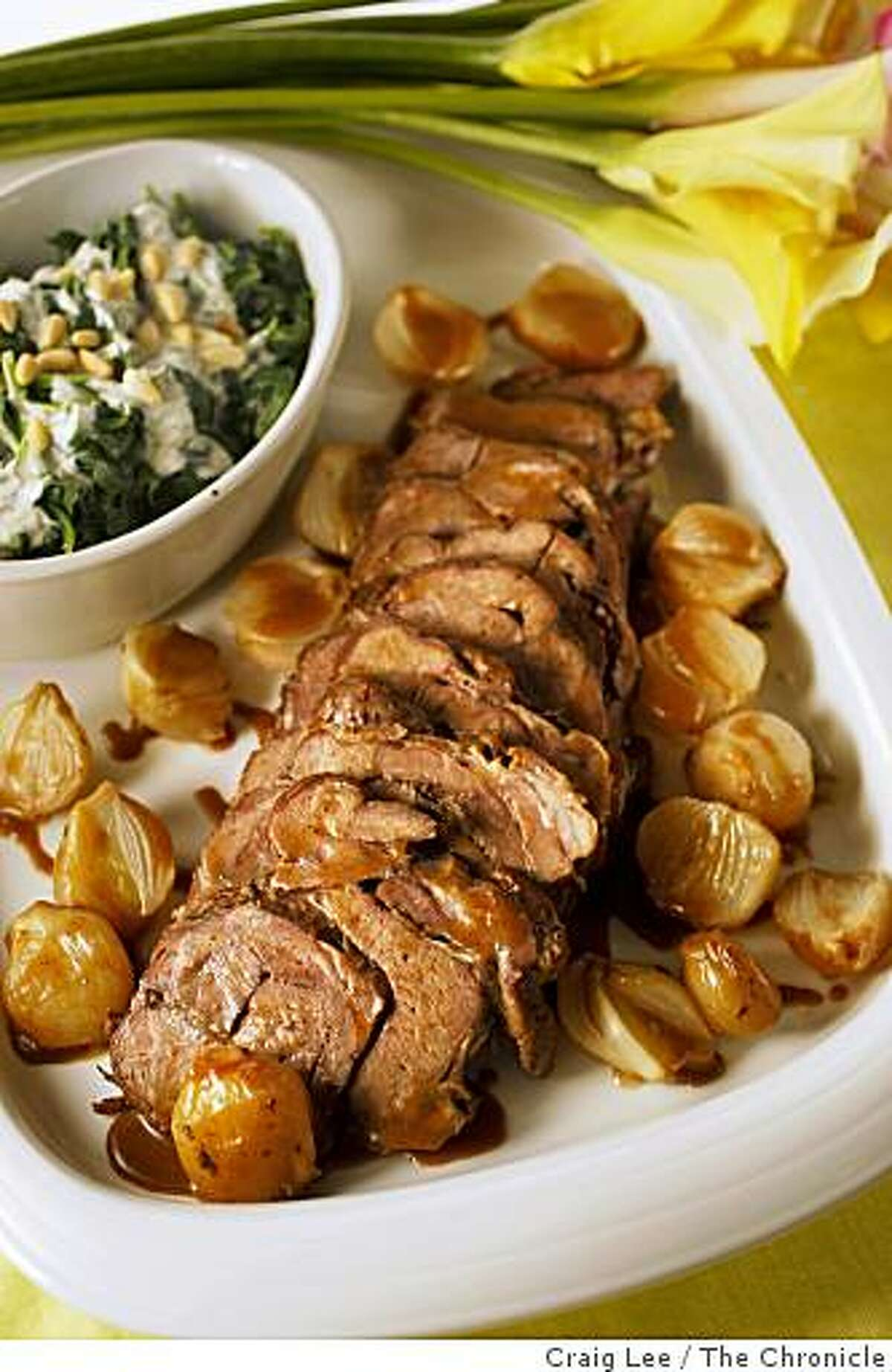 Braised Lamb Shoulder with Buttered Spinach, Yogurt Sauce and Pine Nuts in San Francisco, Calif., on March 25, 2009. Food styled by Shannon Shafer.