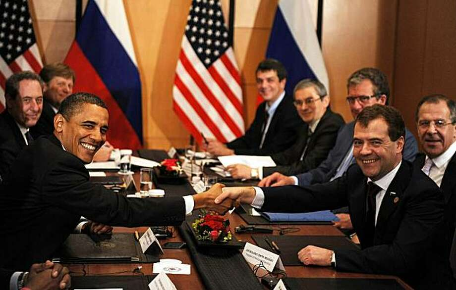 US President Barack Obama (L) shakes hands with Russian President Dmitry Medvedev during a bilateral meeting in Yokohama on November 14, 2010, on the sidelines of The Asia Pacific Economic Cooperation (APEC) summit.   US President Barack Obama assured Russian President Dmitry Medvedev in talks that he would press the US Senate to ratify the new START nuclear arms reduction pact this year. Photo: Tim Sloan, AFP/Getty Images