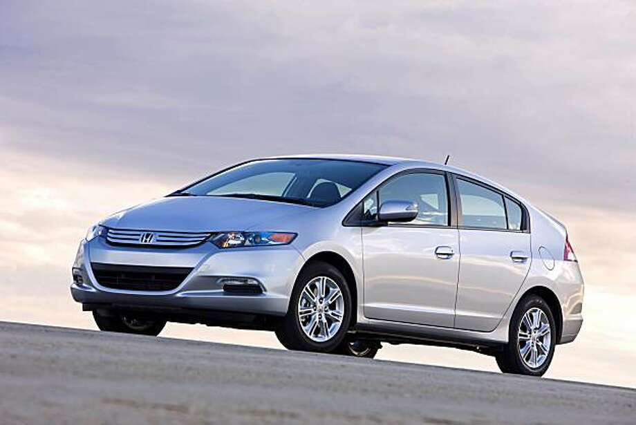 Honda's all-new 2010 Insight four-door hatchback is a gas-electric hybrid delivering an estimated city/highway miles per gallon of 40/43. Photo: Courtesy Of Honda