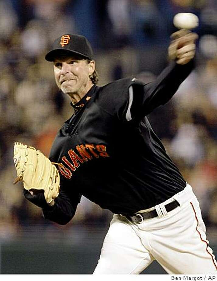 San Francisco Giants' Randy Johnson works against the Oakland Athletics during the second inning of an exhibition  baseball game Friday in San Francisco. Photo: Ben Margot, AP