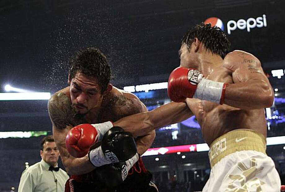 Manny Pacquiao, right, lands a right against Antonio Margarito during the fifth round of their WBC light middleweight title boxing match Saturday, Nov. 13, 2010, in Arlington, Texas. Photo: David J. Phillip, AP