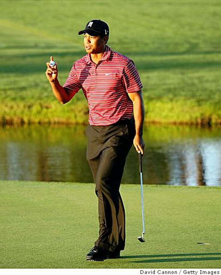ORLANDO, FL - MARCH 29:  Tiger Woods of the USA makes a par at the 16th hole during the final round of the Arnold Palmer Invitational Presented by Mastercard at the Bay Hill Club and Lodge on March 29, 2009 in Orlando, Florida  (Photo by David Cannon/Getty Images) Photo: David Cannon, Getty Images