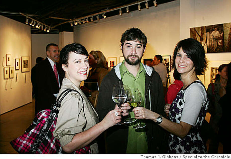 """The Academy of Art University Photography Auction raised funds for the Student Scholarship Fund. left to right: Brittany Boyd, Aaron Bonsall, and Jennifer Crocks.SAN FRANCISCO, CA (February 2, 2009) � The Academy of Art University is building on the success of its Annual Fine Art Auctions and focusing on photography in its First Annual Faculty & Alumni Fine Art Photography Auction on Saturday, March 7, 2009. With special thanks to Bonhams & Butterfields, AAU offers a unique opportunity to support emerging student artists while acquiring works by top photographers in the international market today.  Fifty percent of all proceeds from the sale of fine art photography are tax deductible and will be directly donated to the university�s Student Scholarship Fund.  Many pieces from the expertly juried show are priced at below-market-value to encourage frequent bidding.        The impressive list of participating contemporary masters, including David Arnold, Alyson Belcher, Cissy Spindler, and Reid Yalom, are offering remarkable works representative of their artistry and innovation.  All participating artists are either graduates or instructors in AAU�s influential and dynamic School of Photography.  Preview the 2009 Fine Art Photography Auction Catalogue online at  HYPERLINK """"http://www.academyart.edu/auction_march_2009/"""" http://www.academyart.edu/auction_march_2009/. Photo: Thomas J. Gibbons, Special To The Chronicle"""