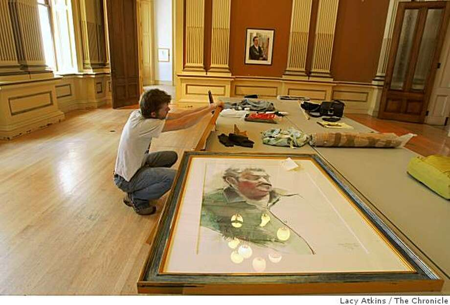 Nate Taylor works on the frame of one of artist Elaine Badgley Arnoux's paintings on Monday March 31, 2009, at the Old U.S. Mint in San Francisco, Calif. Photo: Lacy Atkins, The Chronicle