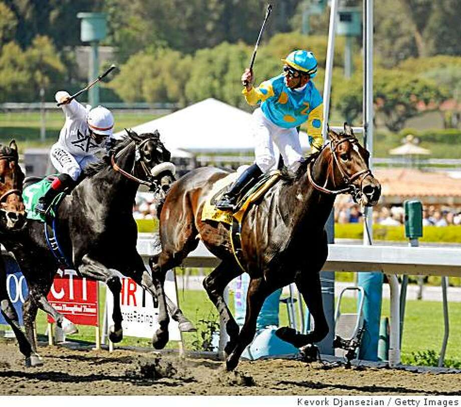 SANTA ANITA, CA - APRIL 04:  Garrett Gomez (R) celebrates after riding Pioneerof the Nile to win the Santa Anita Derby on April 4, 2009 in Santa Anita, California.  Mr Hot Stuff (L) finished third.  (Photo by Kevork Djansezian/Getty Images) Photo: Kevork Djansezian, Getty Images