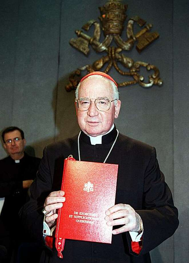 "FILE - In this Tuesday Jan. 26, 1999 file picture, Cardinal Jorge Medina Estevez of Chile, holds the book ""De Exorcismis et Supplicationibus Quibusdam"" (Of Exorcisms and Supplications), the Vatican's new guidelines on exorcism, presented during a news conference at the Vatican. The 1999 guidelines, written in Latin, update the last set written in 1614. After four centuries, The Vatican's guidelines for driving out the devil includes a caveat not to mistake psychiatric illness for diabolic possession. America's Roman Catholic bishops say there's a shortage of exorcists in the country. To fix the problem, they're holding a conference Friday, Nov. 12, 2010 and Saturday in Baltimore on how to perform the rite. Photo: Marco Ravagli, Associated Press"