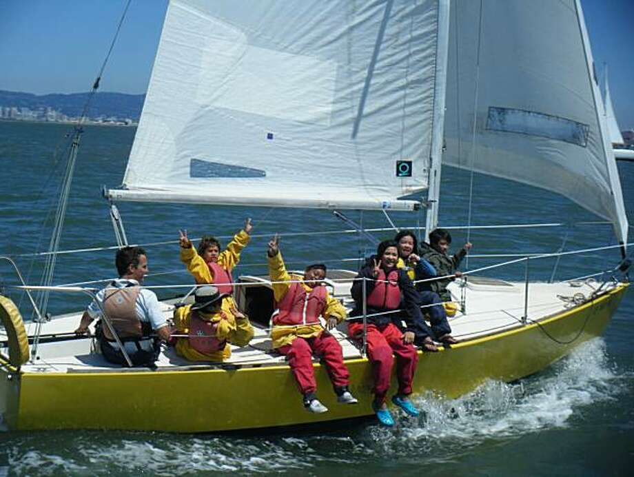 Treasure Island Sailing Center is one of 14 community sailing programs open to all ages on the bay. This group is sailing a J24 keelboat on the bay. Photo: Treasure Island Sailing Center