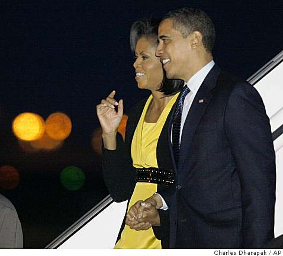 President Barack Obama and first lady Michelle Obama disembark Air Force One at London's Stansted International Airport, Tuesday, March 31, 2009. (AP Photo/Charles Dharapak) Photo: Charles Dharapak, AP