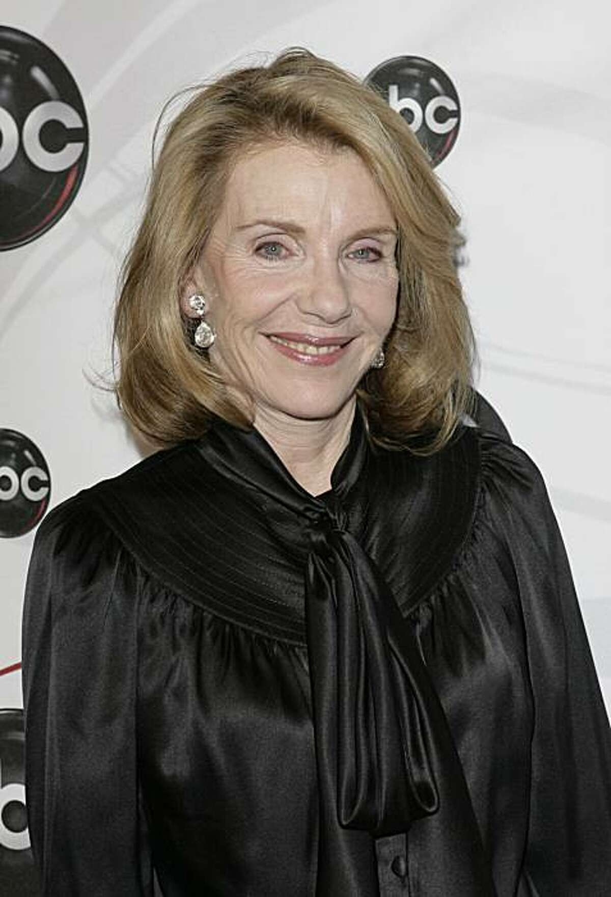 """FILE - In this May 15, 2007 file photo, Jill Clayburgh, star of """"Dirty Sexy Money"""" poses for photographers on the red carpet during the arrivals of ABC's 2007-2008 preview in New York. In one of her final roles Jill Clayburgh plays the mom of charismaticViagra salesman Jamie Reidy (Jake Gyllenhaal) in the romantic comedy """"Love and Other Drugs."""""""