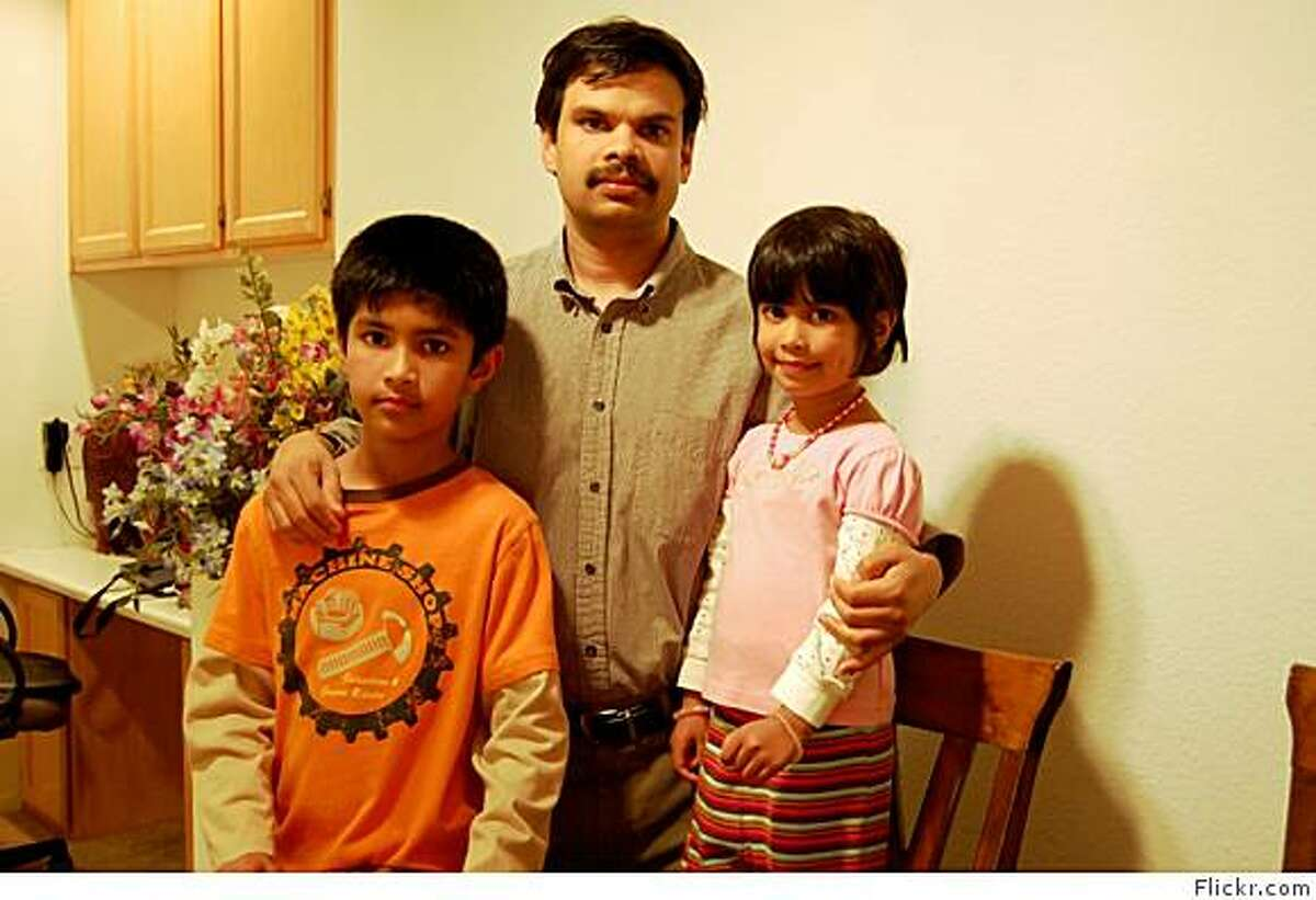 Devan Kalathat poses with his son Akhil Dev, 10, and daughter, Neha Dev, 4, in a photo dated January, 2009 that was posted on Devan's Flickr page in February.