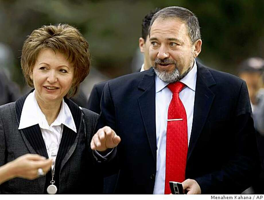 Israel's new Foreign Minister Avigdor Lieberman and his wife Ela attend a handover ceremony at the president's residence in Jerusalem Wednesday, April 1, 2009. Lieberman has begun his term with harsh criticism of past peace efforts. In his first speech since taking office, he said he is opposed to his predecessor's peace talks with the Palestinians over the past year. (AP Photo/Menahem Kahana, Pool) Photo: Menahem Kahana, AP
