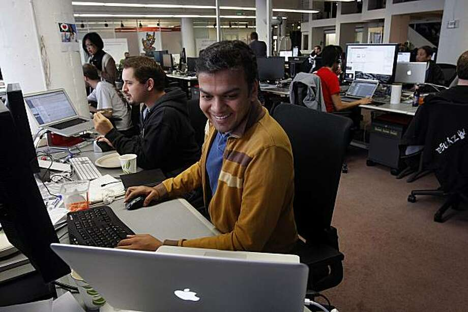 Farmville development manager Gaurav Agarwal (front) at the Portrero Hill offices of Zynga, one of the fastest growing companies offering social games on Facebook and other platforms, in San Francisco, Calif., on Wednesday, October 20, 2010. Photo: Liz Hafalia, The Chronicle