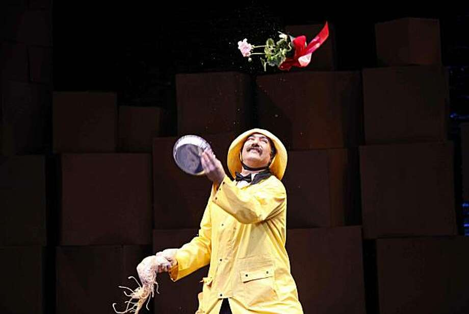 "Paul Magid, co-founder of Flying Karamazov Brothers, in the troupe's latest show ""4Play,"" juggles items brought by the audience for the troupe's traditional Gamble routine Photo: Flying Karamazov Brothers, Courtesy Of Flying Karamazov Bro"