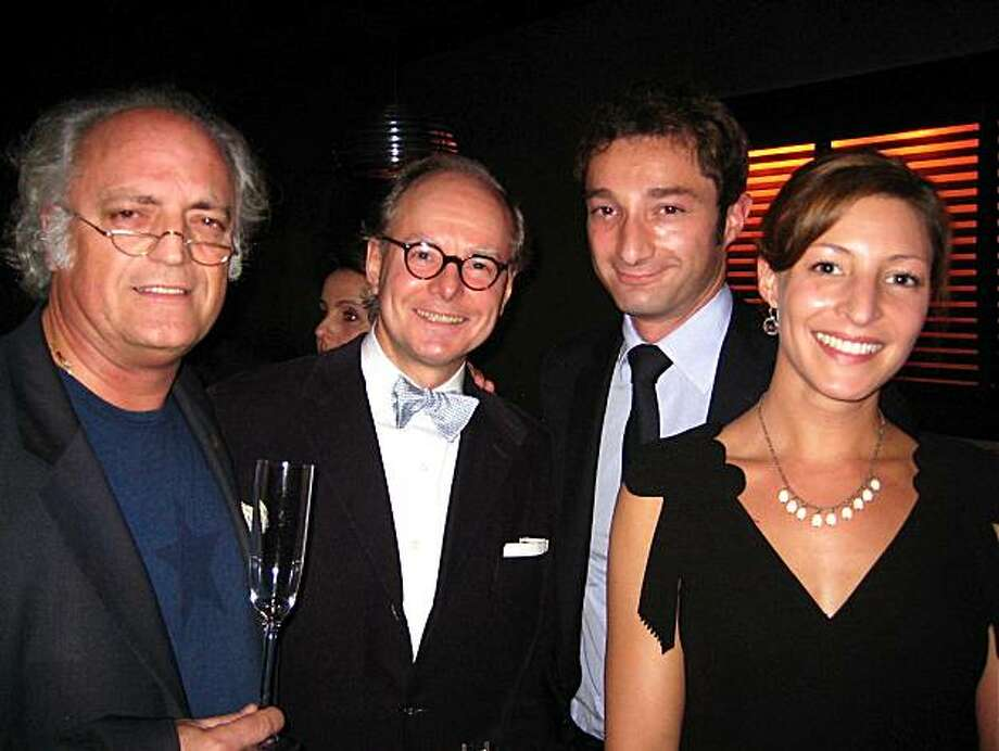 Poet Alain Borer (left) with Modernism gallerist Martin Muller, French Consul General Romain Serman and his wife, Laura Serman, at Bix Restaurant. November 2010. By Catherine Bigelow. Photo: Catherine Bigelow, Special To The Chronicle