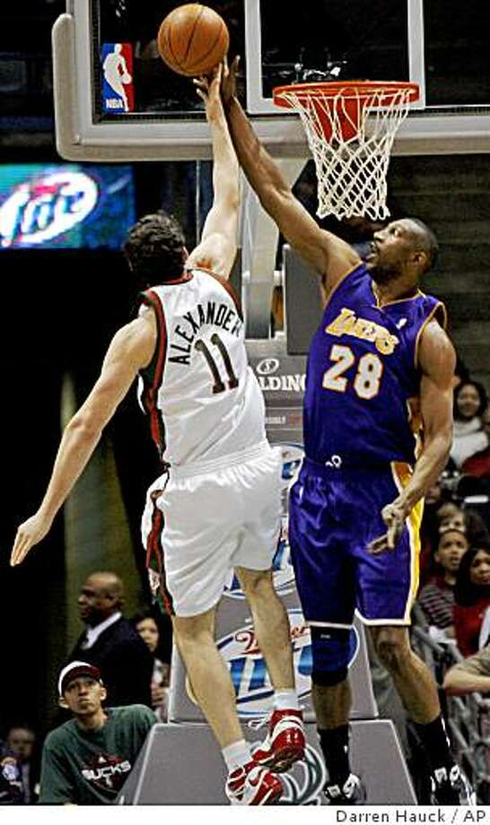 Los Angeles Lakers' D.J. Mbenga, right, blocks the shot from Milwaukee Bucks' Joe Alexander, left, in the first half of an NBA basketball game Wednesday, April 1, 2009,  in Milwaukee.  (AP Photo/Darren Hauck) Photo: Darren Hauck, AP