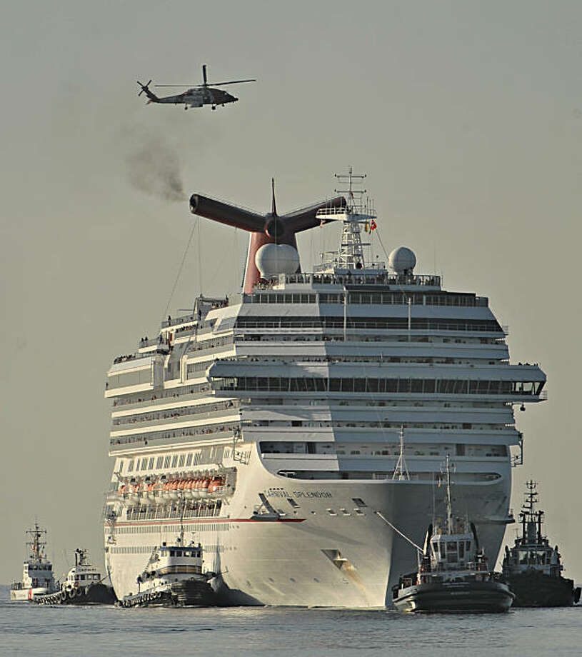 Tugboats tow the disabled cruise ship Carnival Splendor into San Diego Bay on Thursday, Nov. 11, 2010. The ship, which lost power four days ago with nearly 4,500 passengers and crew aboard, was towed from the waters off the coast of Mexico. Photo: Denis Poroy, AP