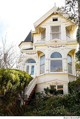 These are exterior shots of 130 Delmar St., a two-story Queen Anne near Buena Vista Park in San Francisco. Built in 1890, it's currently listed on the market for $1.7 million. We should credit Barry Brostoff. Photo: Barry Brostoff