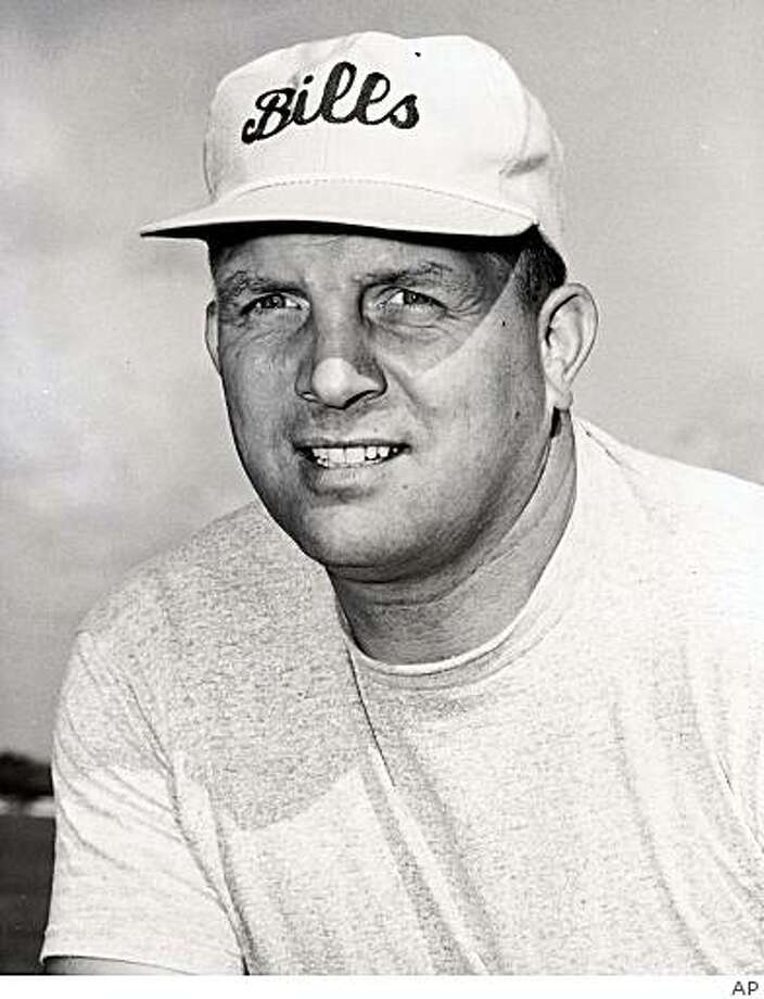 ** FILE ** In this 1963 file photo provided by the Buffalo Bills, Buffalo Bills football coach Lou Saban poses for a photo. Saban, who coached O.J. Simpson in the NFL and ran the New York Yankees for George Steinbrenner during a well-traveled career that spanned five decades, died Sunday, March 29, 2009. He was 87. (AP Photo/Buffalo Bills, File) ** NO SALES ** Photo: AP