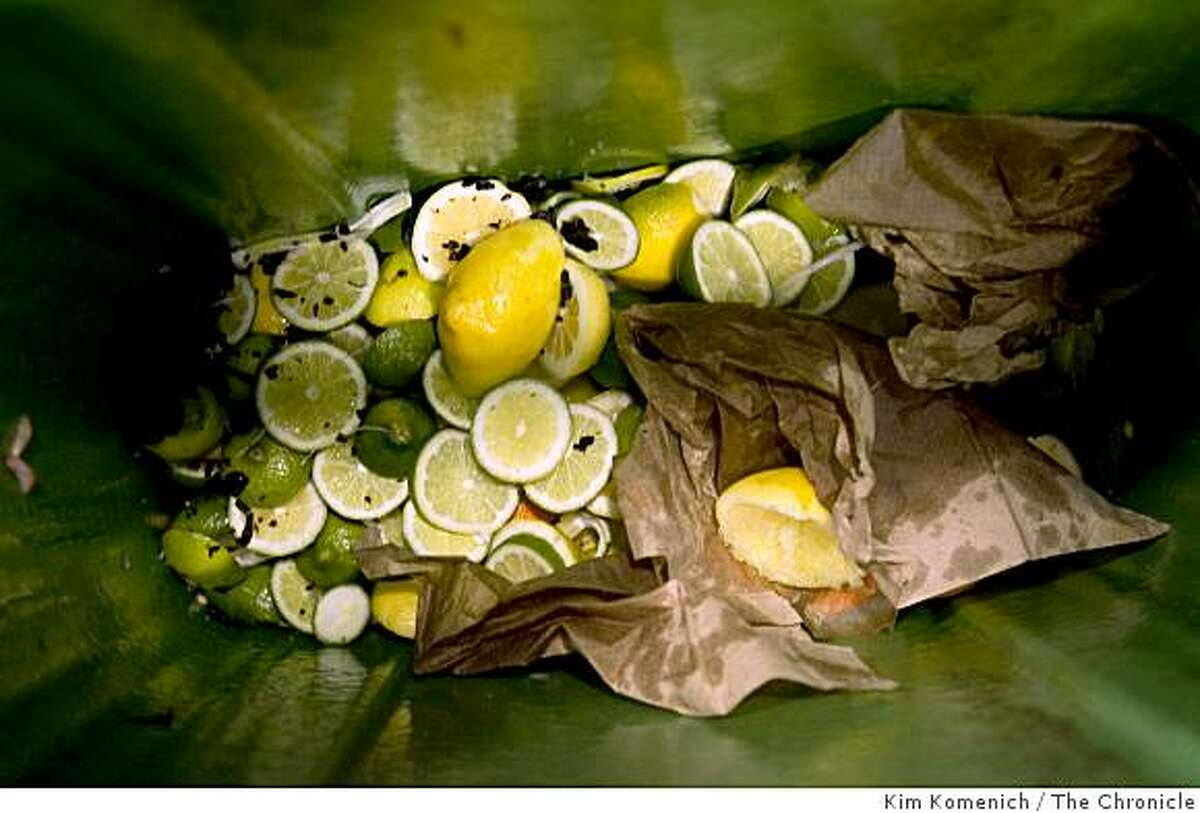 """Lemons and limes are collected in a """"Slim Jim"""" foodscrap container at the Slanted Door Restaurant in San Francisco."""