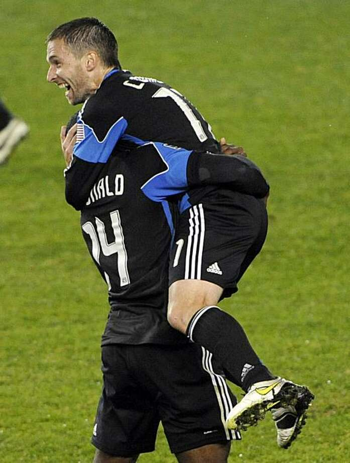 San Jose Earthquakes' Bobby Convey, right, jumps into the arms of Brandon McDonald after the Earthquakes beat the New York Red Bulls 3-1 in an MLS soccer Eastern Conference semifinal on Thursday, Nov. 4, 2010, in Harrison, N.J. The Earthquakes advanced tothe conference final. Photo: Bill Kostroun, AP