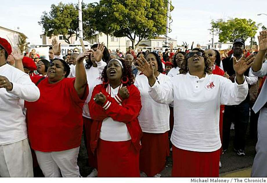 From left to right, Elizabeth Anderson, Linda Bogard and Princess Ayers of the Acts Full Gospel Church raise their arms inprayer as a coalition of pastors from throughout Oakland held a prayer rally for peace and calm at Eastmont Mall in Oakland, Calif., on March 31, 2009. Photo: Michael Maloney, The Chronicle