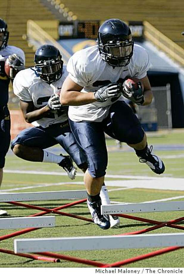 Cal fullback Brian Holley (right) runs through agility drills during a spring football practice at Memorial Stadium on the UC Berkeley campus on March 31, 2009. Photo: Michael Maloney, The Chronicle