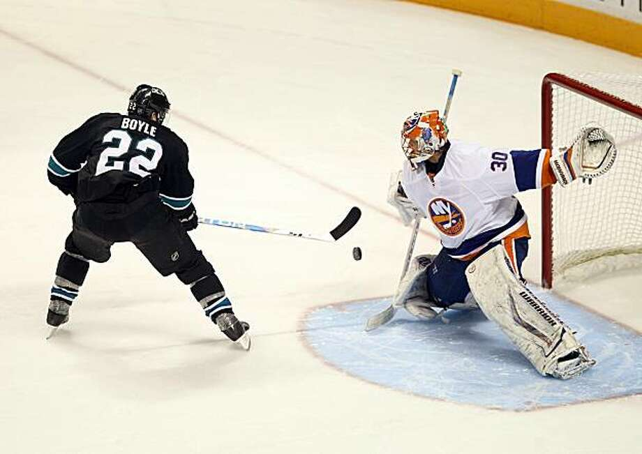 SAN JOSE, CA - NOVEMBER 11:  Dan Boyle #22 of the San Jose Sharks scores a goal past Dwayne Roloson #30 of the New York Islanders in a overtime shoot out to clinch the victory for the Sharks  on November 11, 2010 in San Jose, California. Photo: Ezra Shaw, Getty Images