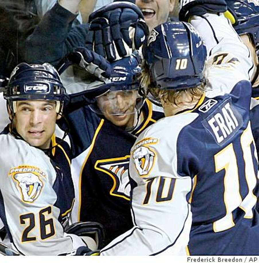 Nashville Predators  Steve Sullivan (26) and  Martin Erat (10), of the Czech Republic, congratulate Cal O'Reilly on his first NHL goal against the Los Angeles Kings during the first period of an NHL hockey game in Nashville, Tenn., Saturday, March 28, 2009. (AP Photo/Frederick Breedon) Photo: Frederick Breedon, AP