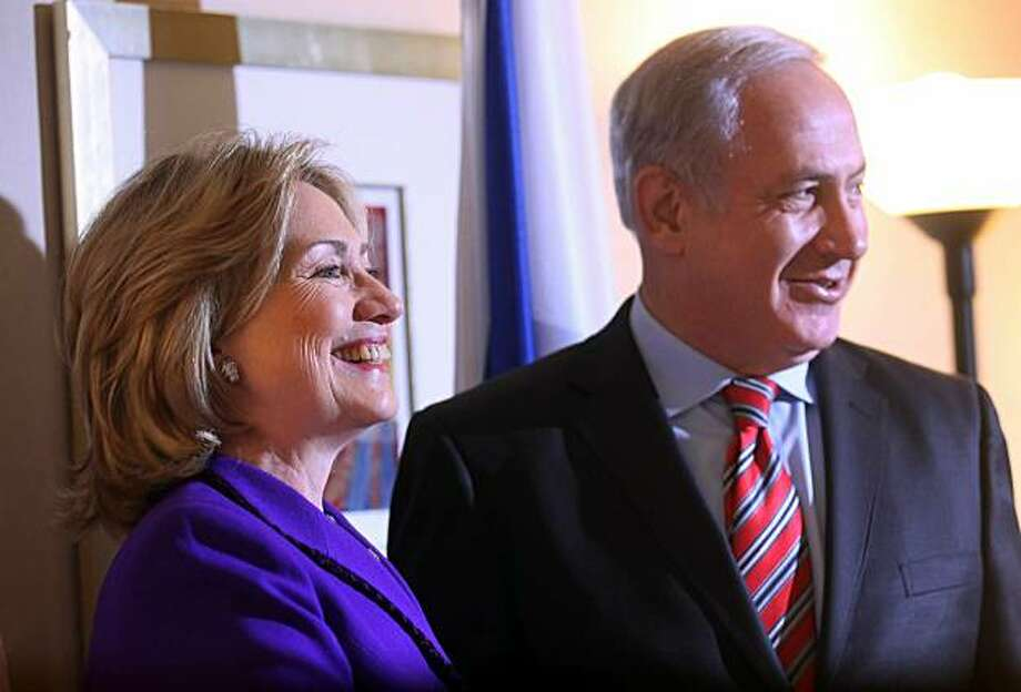 NEW YORK - NOVEMBER 11:  Israeli Prime Minister Benjamin Netanyahu (R) and U.S. Secretary of State Hillary Rodham Clinton speak with the media prior to their meeting November 11, 2010 in New York City. The two were expected to discuss the rift over settlements in Arab East Jerusalem and other Mideast peace issues. Photo: Mario Tama, Getty Images