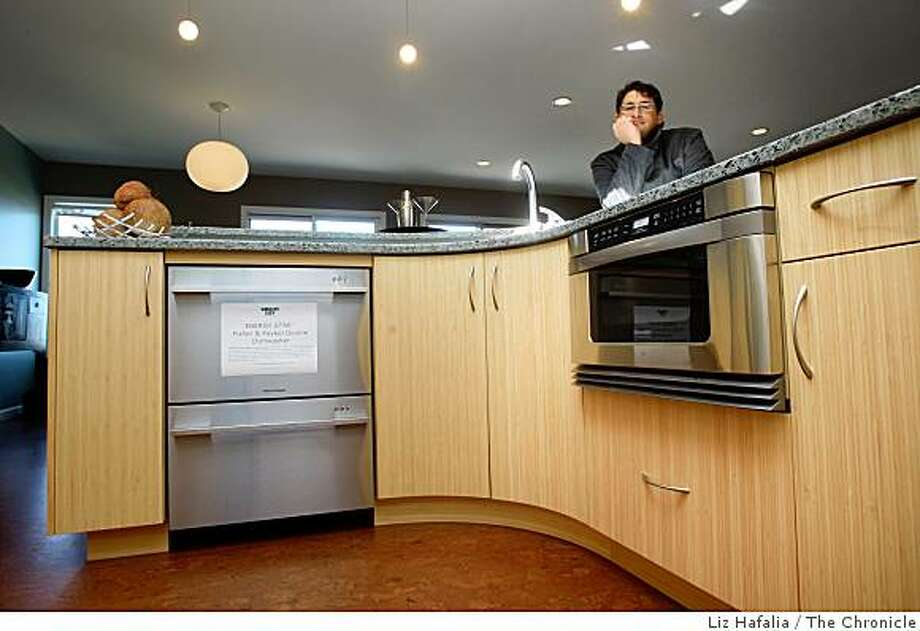 Helmut Schmidt in the kitchen with energy efficient appliances at 2139 39th Ave. which he remodeled into one of the most sustainable homes in San Francisco, Calif., on Monday, March 23, 2009. Photo: Liz Hafalia, The Chronicle