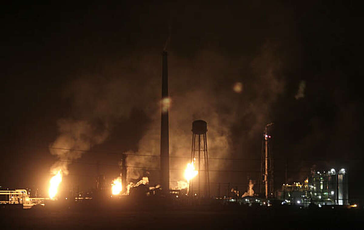 In this file photo, the Tesoro Golden Eagle refinery spews smoke from it's smokestacks in Martinez.