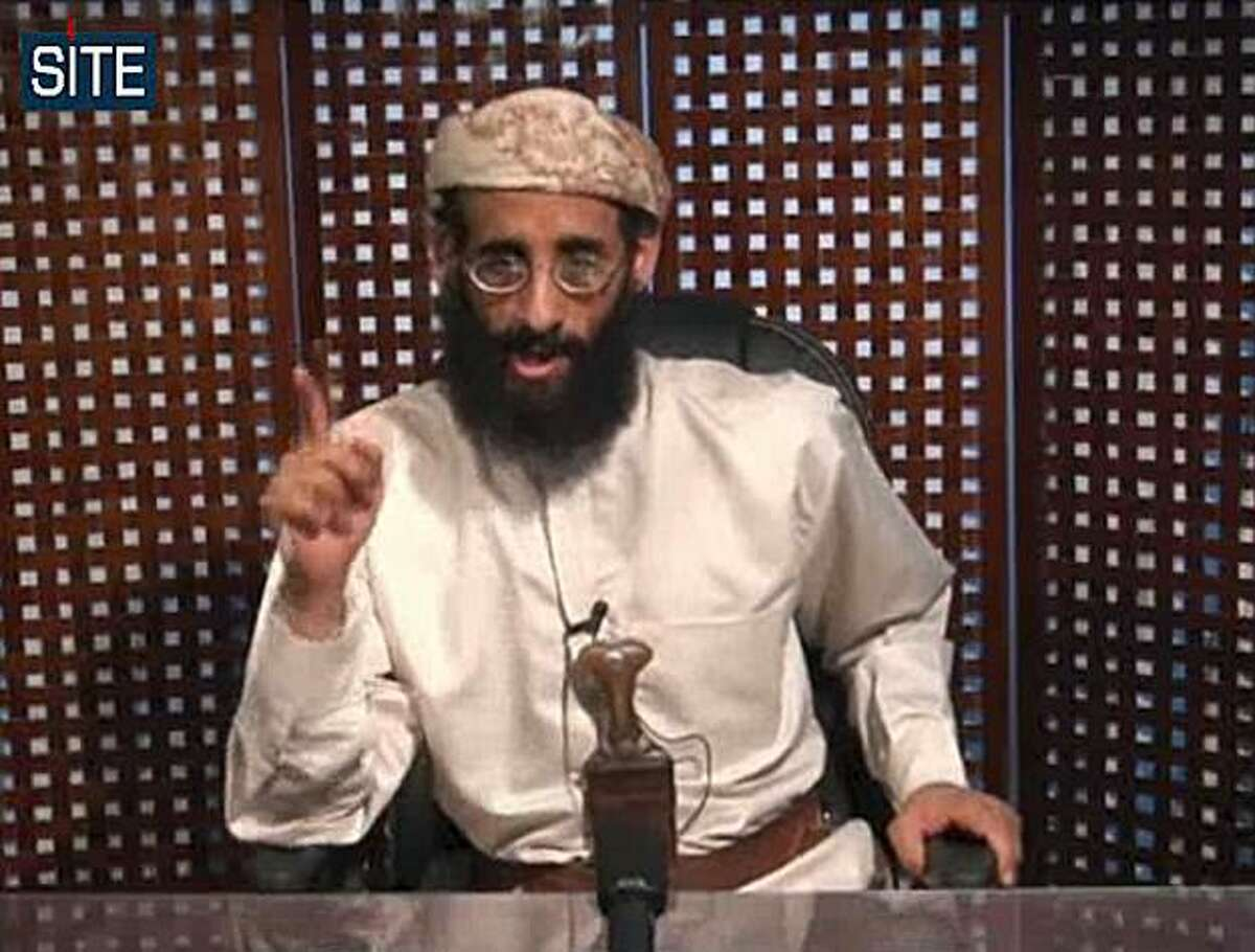 In this image taken from video and released by SITE Intelligence Group on Monday, Nov. 8, 2010, Anwar al-Awlaki speaks in a video message posted on radical websites. Al-Awlaki, the U.S.-born radical Yemeni cleric linked to previous attacks on the U.S., called for Muslims around world to kill Americans in the new video message. Anwar al-Awlaki said since all Americans are the enemy, clerics don't need to issue any special fatwas or religious rulings allowing them to be killed.