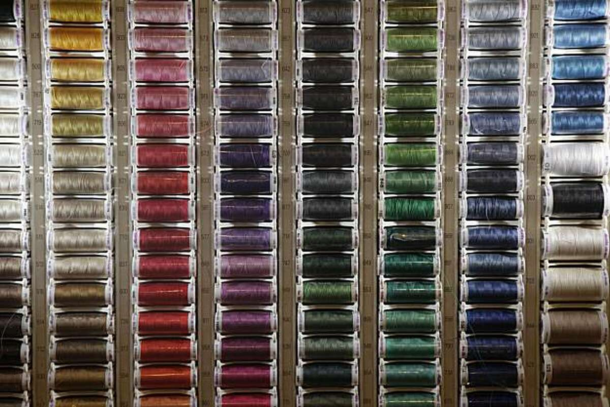 Spools of thread are seen in a display at The Sewing Workshop owned by Karine Langan in San Francisco, Wednesday, Oct. 13, 2010.