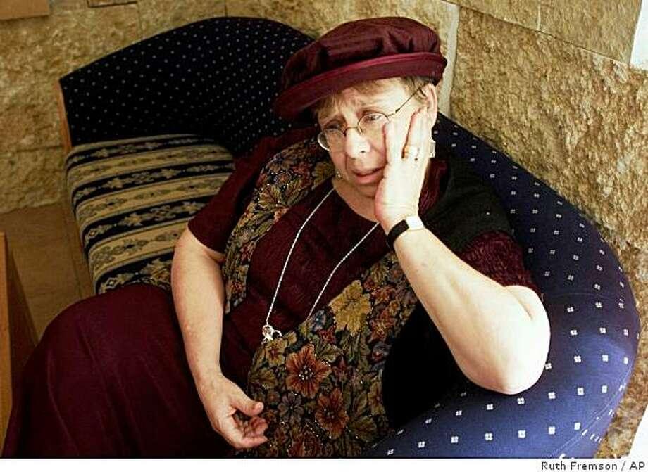 ** FILE ** In this Sept. 8, 1999 file photo. Esther Wachsman, mother of Israeli soldier Nahshon Wachsman who was kidnapped and killed by members of Hamas group, is seen in Jerusalem.  A federal judge on Friday, March 27, 2009,  ordered Iran to pay $25 million plus interest to the family of Israeli soldier Nachshon Wachsman, who was kidnapped and executed by Hamas in 1994. (AP Photo/Ruth Fremson, File) Photo: Ruth Fremson, AP
