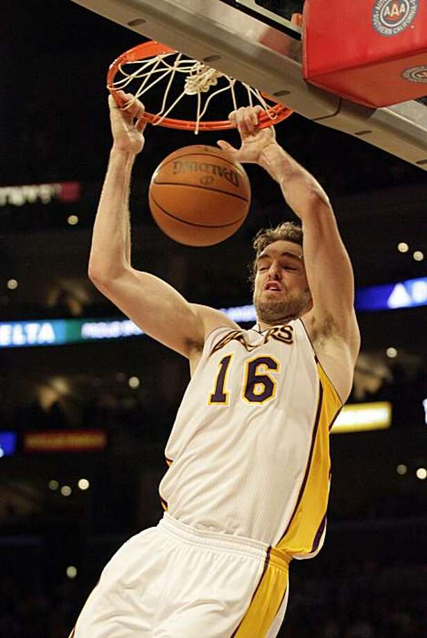 Los Angeles Lakers' Pau Gasol, of Spain, dunks the ball against the Portland Trail Blazers in the second half of a basketball game in Los Angeles, on Sunday, Nov. 7, 2010. Photo: Francis Specker, AP