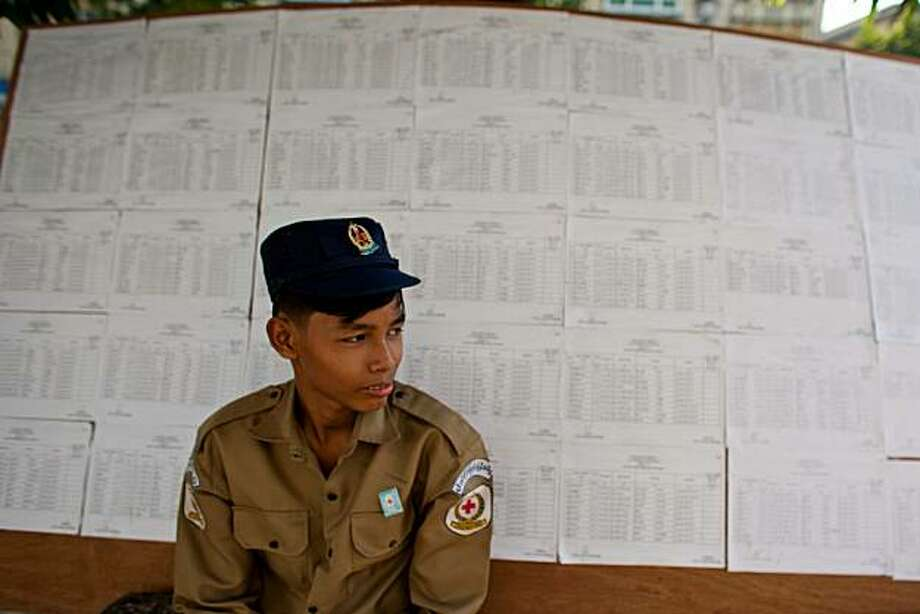 YANGON, BURMA - NOVEMBER 07:  A security guard sit in front of voter list near vote station downtown of Yangon on November 7, 2010 in Yangon, Burma. Photo: Ckn, Getty Images