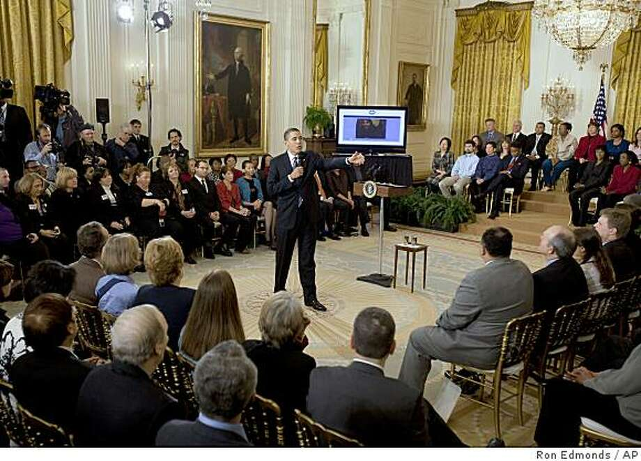 President Barack Obama takes part in an Internet town hall meeting, Thursday, March 26, 2009, in the East Room of the White House in Washington. (AP Photo/Ron Edmonds) Photo: Ron Edmonds, AP