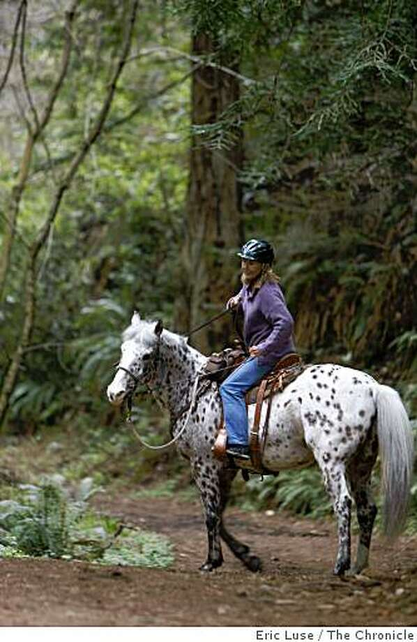 Tanya Ballard, San Mateo, rides her horse Renno along the Purissima Creek Trail near  Half Moon Bay photographed on Friday, March 13, 2009. Photo: Eric Luse, The Chronicle