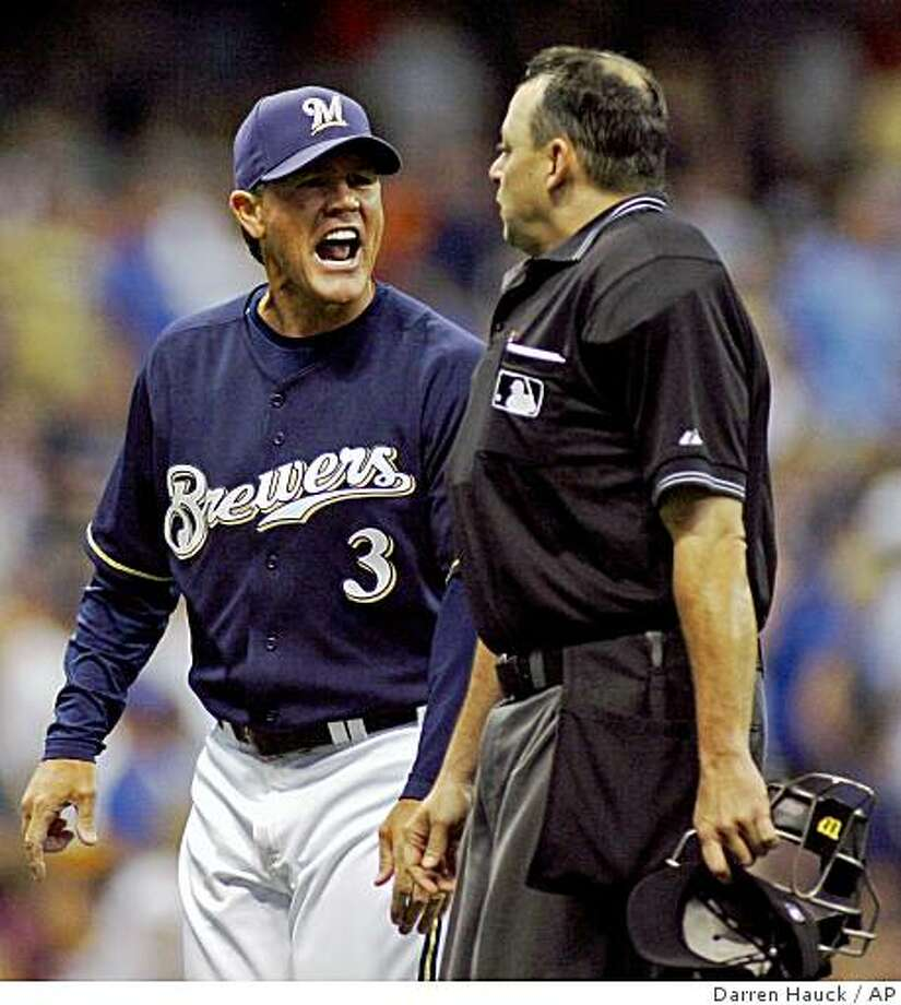 ** FILE ** In this Aug. 23, 2008 file photo, Milwaukee Brewers manager Ned Yost, left, argues with home plate umpire Andy Fletcher after a fan interference call in the sixth inning of a baseball game against the Pittsburgh Pirates in Milwaukee.  The Brewers fired manager Ned Yost on Monday Sept. 15, 2008 with the team mired in a late-season slump that has jeopardized its chances of making the playoffs for the first time since 1982.  (AP Photo/Darren Hauck, File) Photo: Darren Hauck, AP