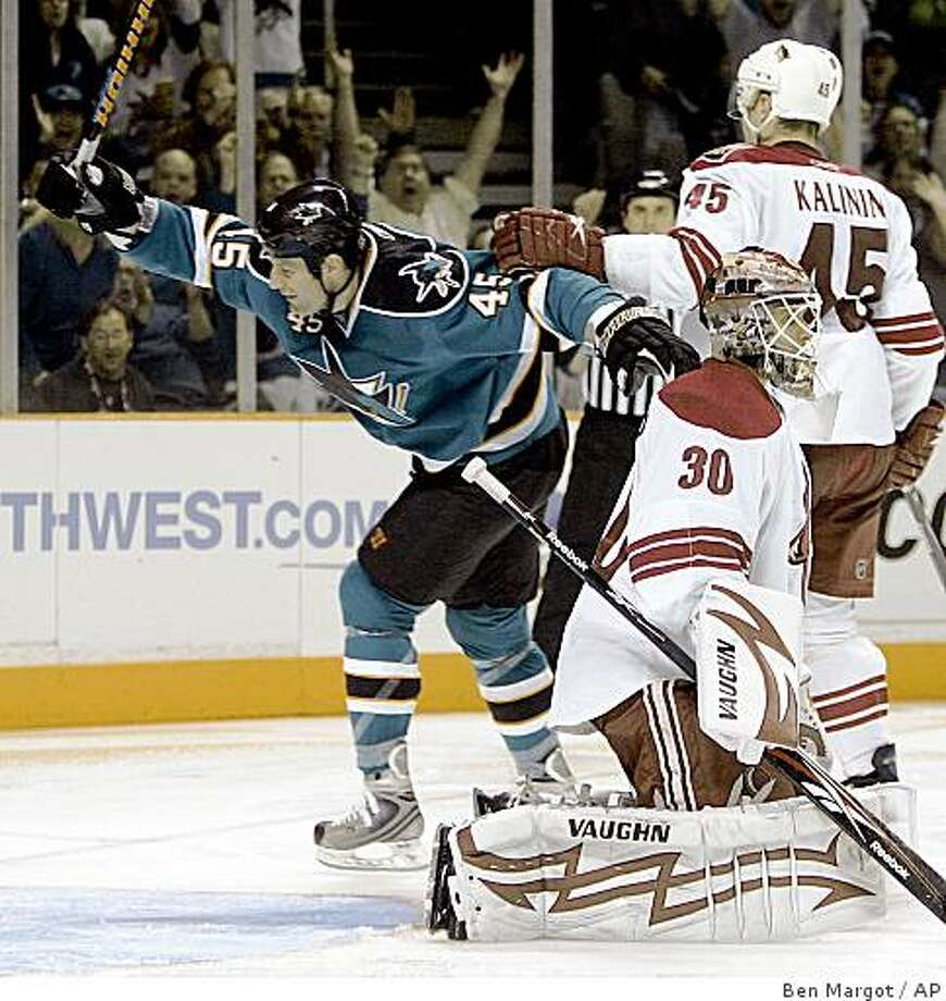 San Jose Sharks'  Jody Shelley (45) celebrates his goal against Phoenix Coyotes goalie Ilya Bryzgalov (30), of Russia, during the second period of an NHL hockey game Saturday, March 28, 2009, in San Jose, Calif. (AP Photo/Ben Margot) Photo: Ben Margot, AP