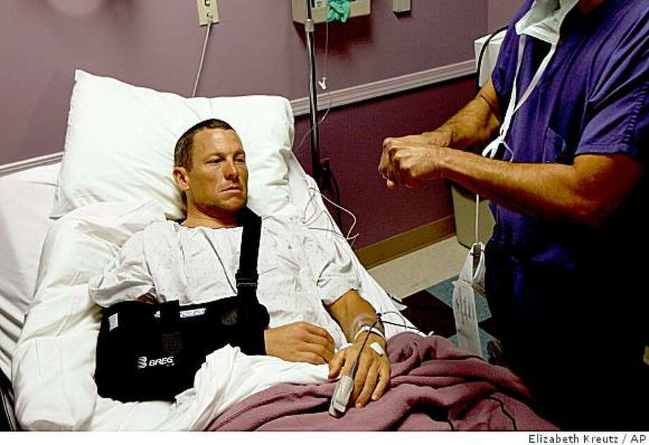 In this photo provided by Elizabeth Kreutz, seven-time Tour de France Champion Lance Armstrong listens to Dr. Douglas Elenz before surgery on his broken right collarbone Wednesday, March 25 2009, in Austin, Texas. Photo: Elizabeth Kreutz, AP