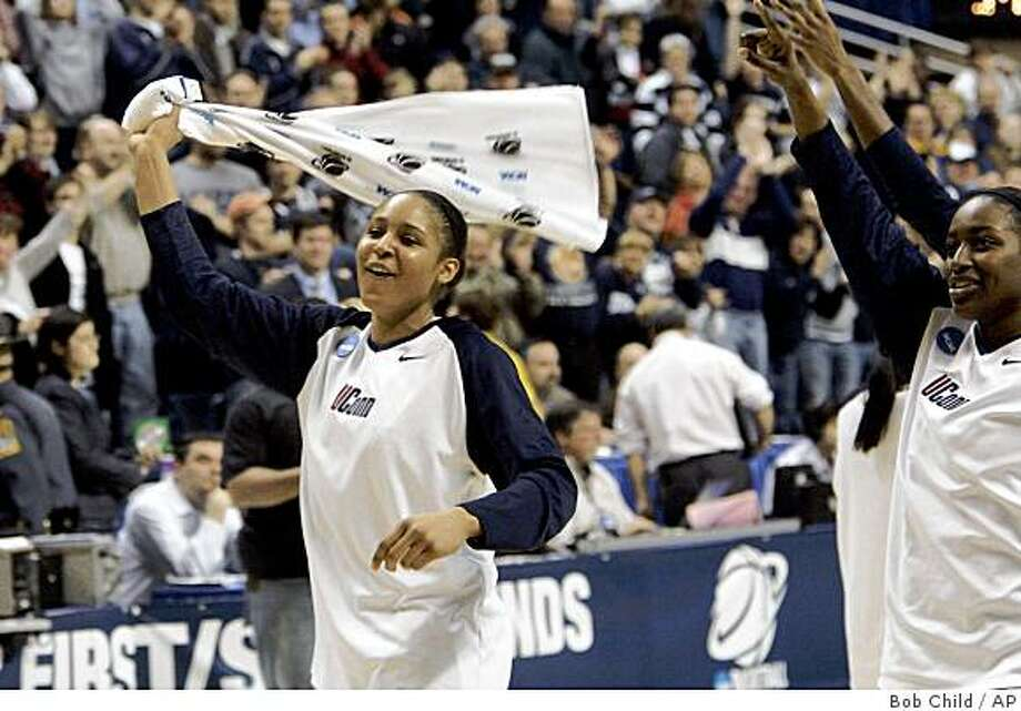 Connecticut's Maya Moore smiles and waves a towel as she tours the sidelines after a second-round game in the NCAA women's college basketball tournament in Storrs, Conn., Tuesday, March 24, 2009. Connecticut defeated Florida 87-59. (AP Photo/Bob Child) Photo: Bob Child, AP