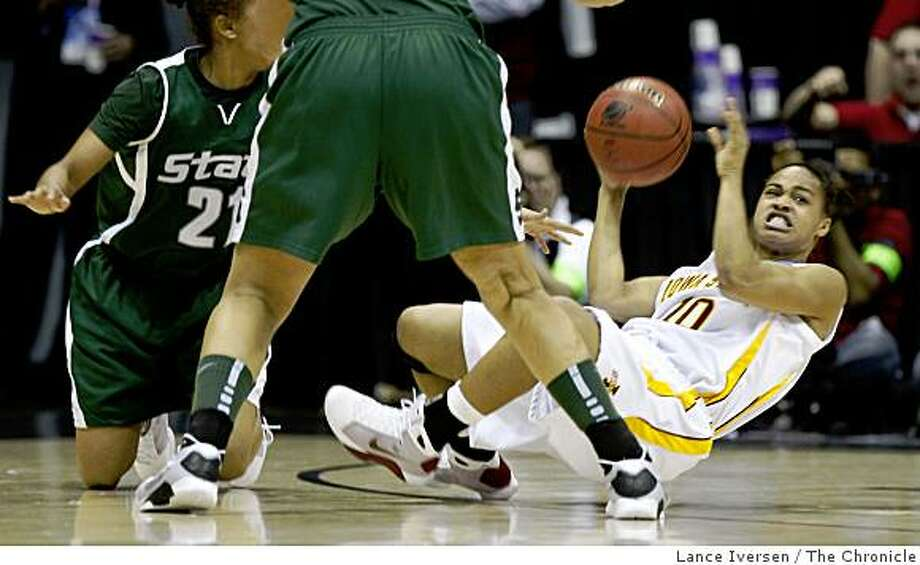 Iowa State #10 Denae Stuckey passes off in 2nd half action. Iowa State defeated Michigan State 69-68 to advance to the elite eight in the NCAA Women's Championships Saturday, March 28, 2009. Photo: Lance Iversen, The Chronicle