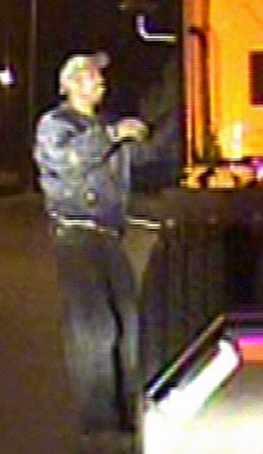 This image made from surveillance video released by the Riverside Police Department Monday, Nov. 8, 2010, shows a man authorities say they believe is the gunman suspected of fatally shooting Riverside police officer Ryan Bonaminio earlier in the day. Photo: Riverside Police Dept., AP